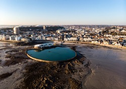 Havre des Pas public bathing pool drone shot at low tide