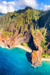 Hawaii beach, Kauai. Na pali coast view from helicopter. Hawaiian travel destinaton. Napali coastline in Kaui, Hawaii, USA. Aerial of Honopu arch.