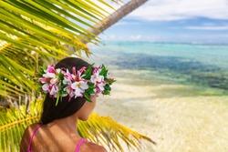 Hawaii beach woman luau dancer relaxing wearing wreath of fresh flowers on Tahiti Bora Bora, French Polynesia.