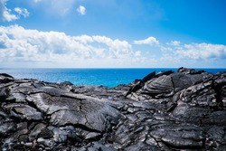 hawaii big island volcano national park lava magma rocks ocean blue sky