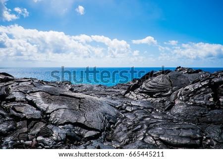 hawaii big island volcano national park lava magma rocks ocean blue sky