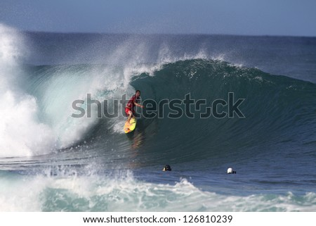 HAWAII - FEBRUARY 1: Kalani Chapman competes in the Volcom Pipe Pro where the waves were ten to fifteen feet February 1, 2013 on the North Shore of Hawaii.