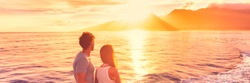 Hawaii holiday cruise ship tourists couple watching sunset on honeymoon travel vacation. Banner panoramic view of Kauai island.