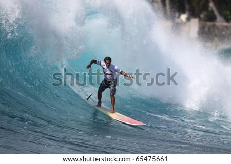 HAWAII - NOV. 4:  Rusty Keaulana competes in the Oxbow World Longboard Championships  November 4, 2010 at Makaha Beach, Hawaii.