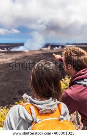 Hawaii scene. Hiking people looking at Hawaiian volcano: Halemaumau crater within the Kilauea Volcano caldera in Hawaii volcanoes national park on Big Island.