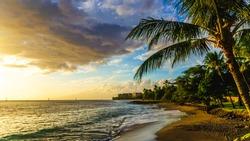 Hawaii Sunset in Maui  on the beach as the sun is setting
