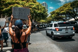 Hawaii, USA.  The banner in the hands of the protesters. Black lives matter - slogan and social issue against violence and systemic racism towards black people.