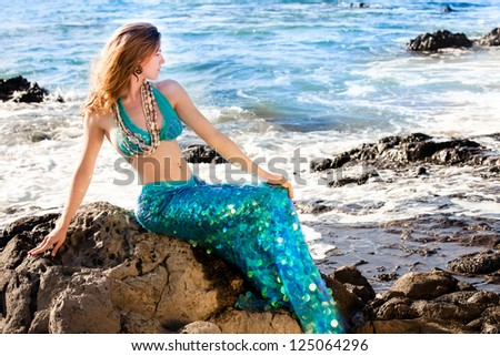 Hawaiian Beautiful Mermaid on Lava Rocks at the Ocean