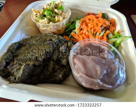 Hawaiian Lau Lau plate Served with Fresh/Day Old Poi in bowl, salad, Tofu poke in a cardboard container on a table. Photo stock ©