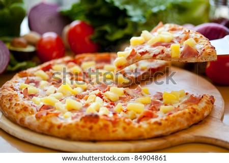 Hawaiian Pizza lifted slice 2