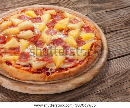 Hawaiian pizza on the old board.