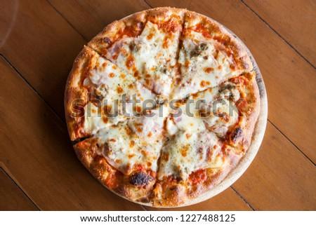 Hawaiian pizza on wooden background #1227488125