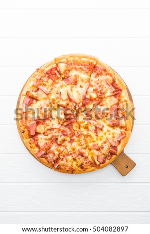 Hawaiian pizza plate on white wooden background #504082897