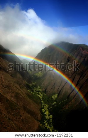 hawaiian rainbow in a ravine between two mountains