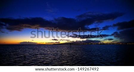 Hawaiian sunset over Ocean off of Waikiki Beach on Oahu, Hawaii