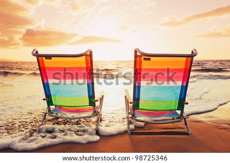 Hawaiian Vacation Sunset Concept, Two Beach Chairs at Sunset - stock photo
