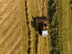 hay cutting and harvesting with hay baling in summer
