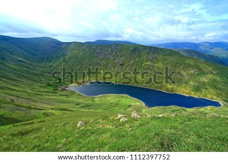 Hayeswater, Gray Crag & Thornthwaite Beacon from The Knott on the High Street Roman Road. This is a glaciated Valley with drumlins caved out by ice. The glacial Tarn is used for hydroelectricity.