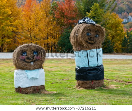 Haystack Family. Cute father and son haystack characters welcome fall visitors in North Carolina