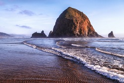 Haystack Rock at Cannon Beach, landmark of the Oregon Coast.