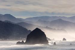 Haystack Rock in Cannon Beach along Oregon Coast in the Pacific Ocean