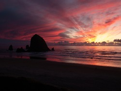 Haystack Rock Silhouette at Cannon Beach, Oregon at Sunset with Bright Colors