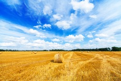 Haystacks field and beautiful blue sky