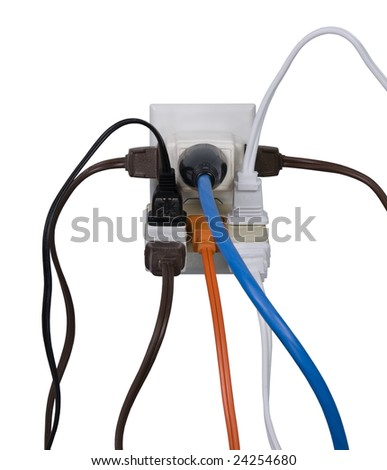 Hazardous overloaded electrical power outlet. - stock photo