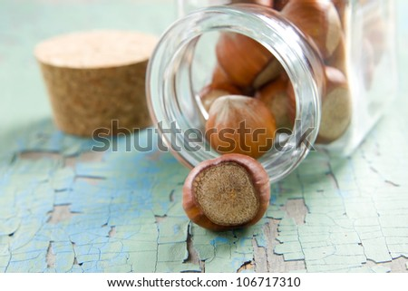 Hazelnuts (filbert) on the vintage wooden surface