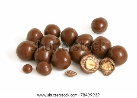 Hazelnuts in chocolate on a white background