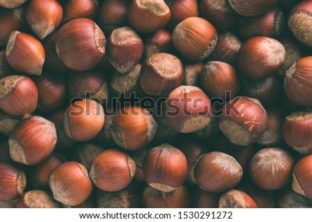 Hazelnuts. Stack of hazelnuts. Food background. Hazelnuts texture. Top view #1530291272