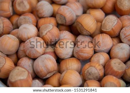 Hazelnuts. Stack of hazelnuts. Food background. Hazelnuts texture. Top view . Hazelnut Nut Health Organic Brown Filbert Autumn Background Concept #1531291841