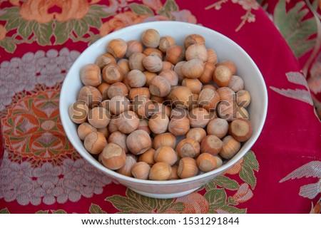 Hazelnuts. Stack of hazelnuts. Food background. Hazelnuts texture. Top view . Hazelnut Nut Health Organic Brown Filbert Autumn Background Concept #1531291844