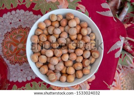 Hazelnuts. Stack of hazelnuts. Food background. Hazelnuts texture. Top view . Hazelnut Nut Health Organic Brown Filbert Autumn Background Concept #1533024032