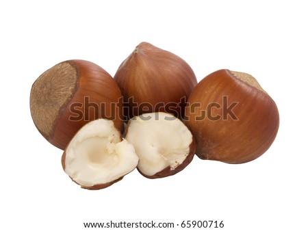 hazelnuts, whole and unshelled, isolated on white.