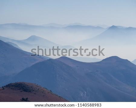 Hazy mountains and arid landscape of Malolotja Nature Reserve, Swaziland, Southern Africa