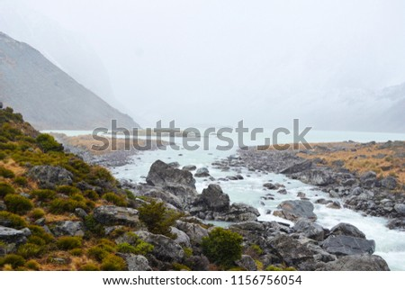 Hazy river at winter near Mt. Aoraki