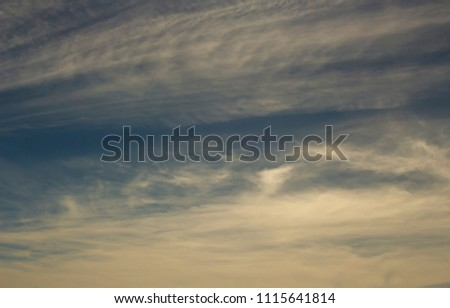 Hazy small cirrostratus, cirrocumulus and cumulus cloud formations on a sunny afternoon  in  early winter  create a hazy background effect.