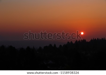 Hazy sunrise in Vancouver, red sun through the wildfire smoke
