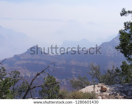 Hazy view of the peaks of Grand Canyon National Park with smoke from a wildfire.