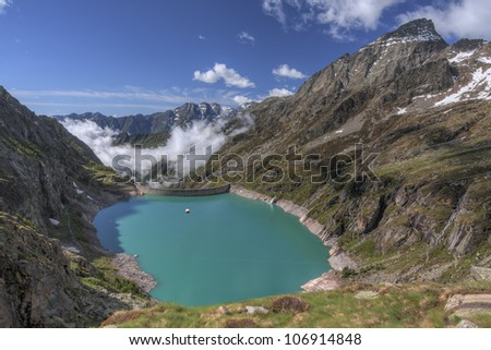HDR Alps landscape. Piantonetto Valley, Gran Paradiso National Park, Piedmont, Italy. The lake is artificial, due to Teleccio dam