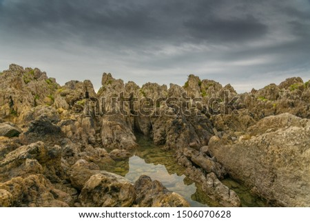 hdr artistic photography of a rocky sea landscape with dramatic dramatic sky #1506070628