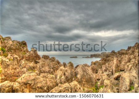 hdr artistic photography of a rocky sea landscape with dramatic dramatic sky #1506070631