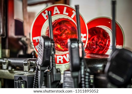 HDR - Firefighter equipment in a fire truck with walkie talkie and halt stop trowel