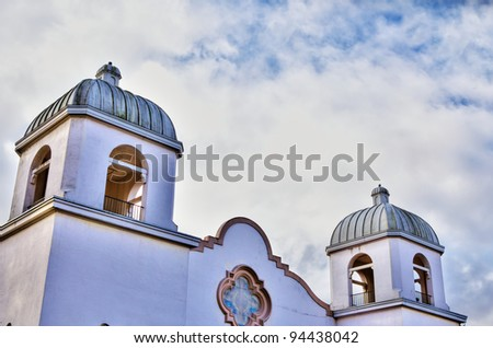 Hdr image of a spanish mission style stucco church with for Mission stucco