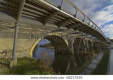 HDR image of an old road bridge with new foot bridge spanning the river Stour at Wimborne, Dorset, UK