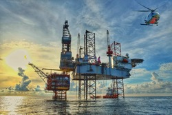 HDR image of Helicopter transfer crews or passenger to work in offshore oil and gas industry,Offshore construction platform for production oil and gas, Oil and gas industry, Production platform.