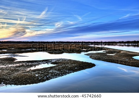hdr image of oyster beds and harbor at sunset