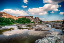 HDR Landscape of Oman. wadi al khoud muscat Oman. Reflection view of Cloud and rock waterfall