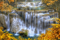 HDR landscape photo, Huay Mae Kamin Waterfall, beautiful waterfall in autumn forest, Kanchanaburi province, Thailand